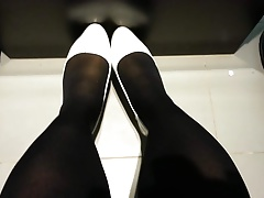 White Patent Pumps with Dark-hued Tights Teaser 9
