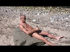 Faggot Henndrik Solo Beach bare jizm on Stone