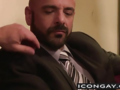 Dirk Caber and Adam Russo sticking each other firm on the couch