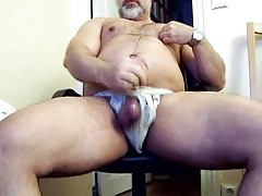 immense father grizzly in jock rope masturbating his immense knob