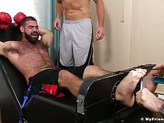Cub boxer Ricky Larkin is roped up by Sergey and his pal